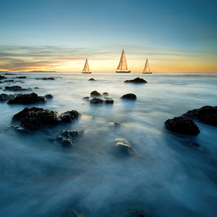 Sailboats on Sea at Dusk